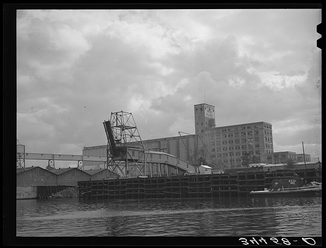 Flour mill and coal loading dock. Port of Houston, Texas