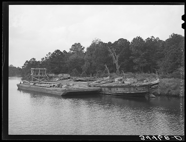 Hulls rotting along the bayou which joins the port of Houston, Texas