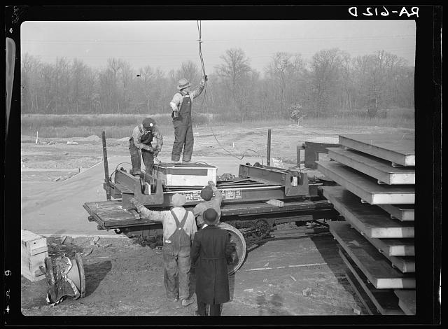 Hightstown, New Jersey. Unloading hoisting rig to be used in the slab factory at Jersey Homesteads, a U.S. Resettlement Administration subsitence homestead project