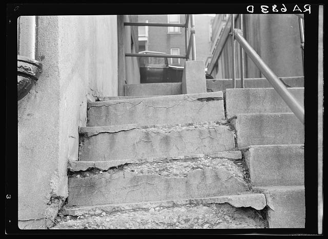 View showing disintegration of concrete stairs at the Model Housing Corporation, Cincinnati, Ohio