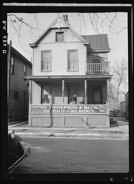 House in Cincinnati showing its conversion into businnesses and blight