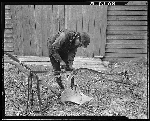 Mending a plow which has been bought through funds advanced by the Resettlement Administration. Virginia