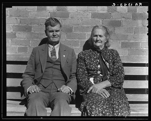 Latter Day Saints portrait group. These people, man and wife, are both eighty-five years old. Converts to Mormonism from South Africa. She was the first schoolteacher in Escalante. They are dressed in their Sunday clothes