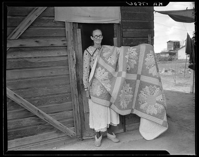 Grandmother from Oklahoma and her pieced quilt. California, Kern County