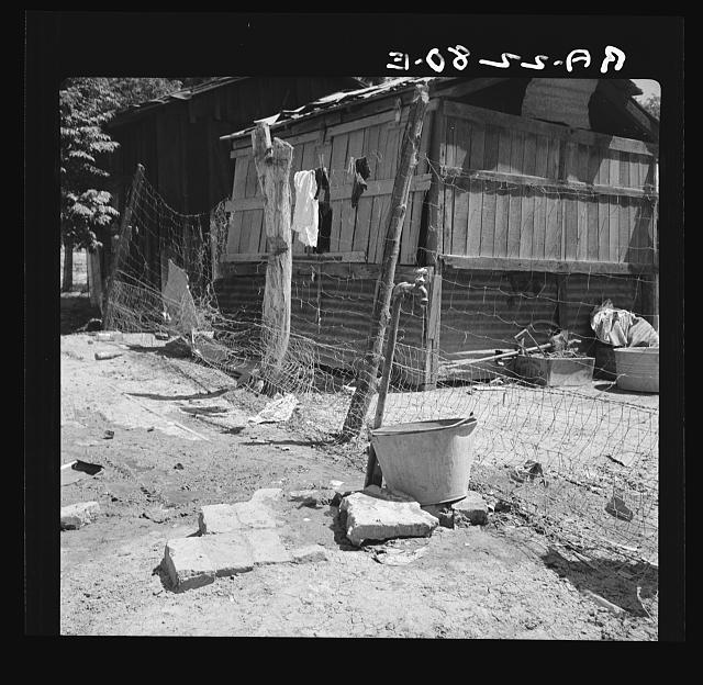 Home of Mexican field worker showing water supply. Brawley, Imperial Valley, California