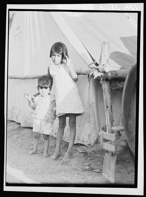 Migrant Mexican children in contractor's camp at time of early pea harvest. Nipomo, California