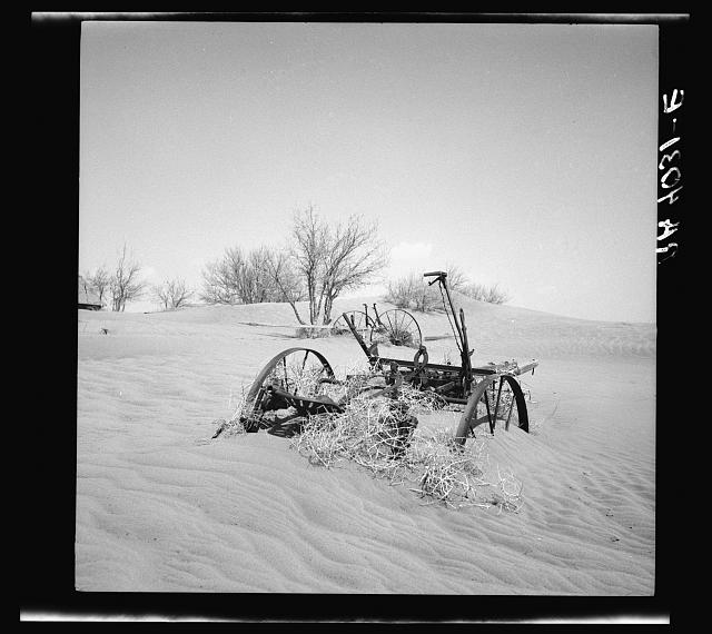 Buried farm machinery. Cimarron County, Oklahoma