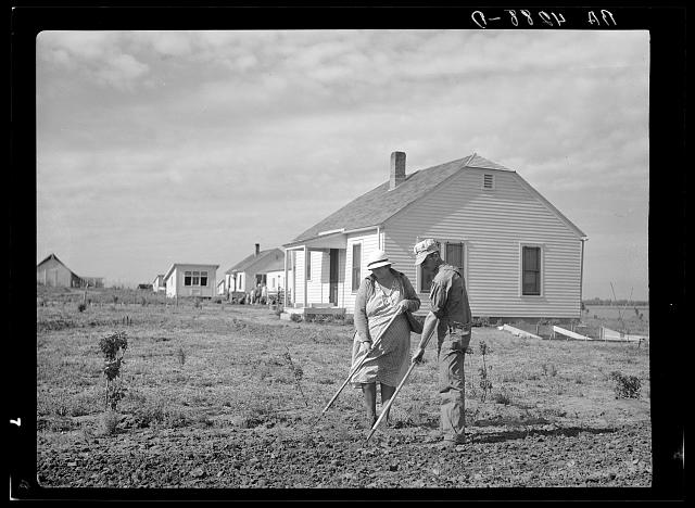 Working in garden. Falls City Farmsteads, Nebraska