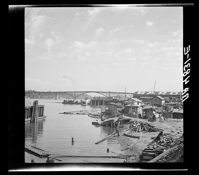 Squatters' shacks along the Willamette River in Portland, Oregon. Many of the men living here during the winter work in the nearby orchards of the Williamette and Yakima Valley in the summer