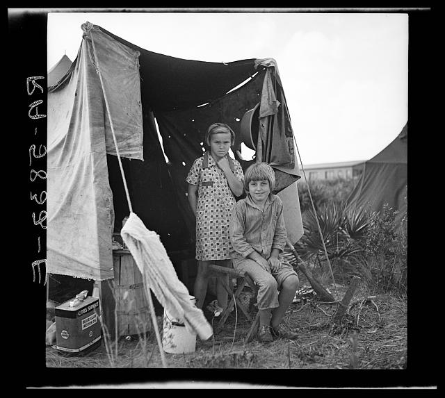 Two children of a migratory fruit worker. Deerfield, Florida