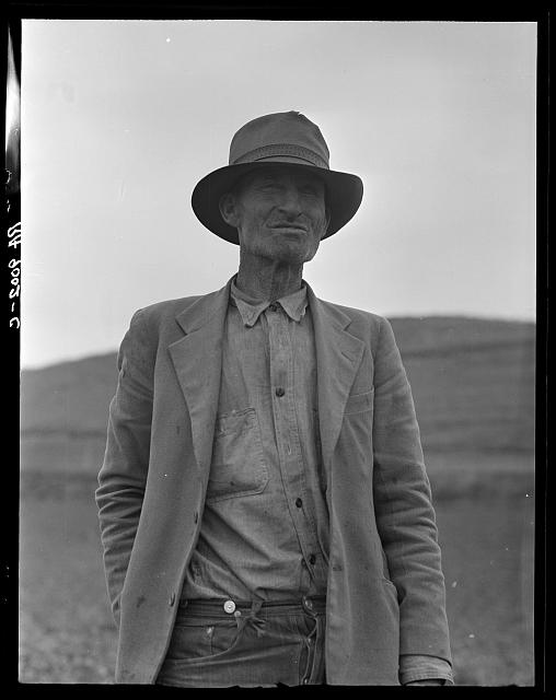 "This man is a labor contractor in the pea fields of California. ""One-Eye"" Charlie gives his views. ""I'm making my living off of these people (migrant laborers) so I know the conditions."" San Luis Obispo County, California"