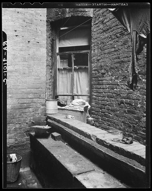 One of the rear windows, tenement dwelling of Mr. and Mrs. Jacob Solomon, 133 Aveue D, New York City. The Solomon family are on the accepted list for resettlement at Hightstown, New Jersey