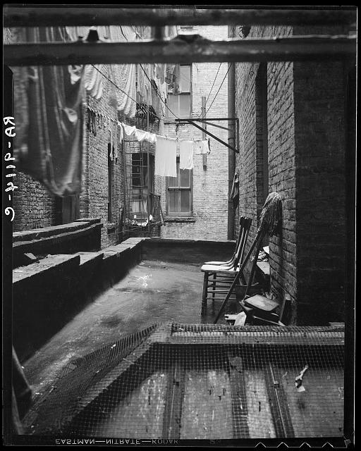 Out of rear window tenement dwelling of Mr. and Mrs. Jacob Solomon, 133 Avenue D, New York City. The Solomon family are all on the accepted list for resettlement at Hightstown, New Jersey