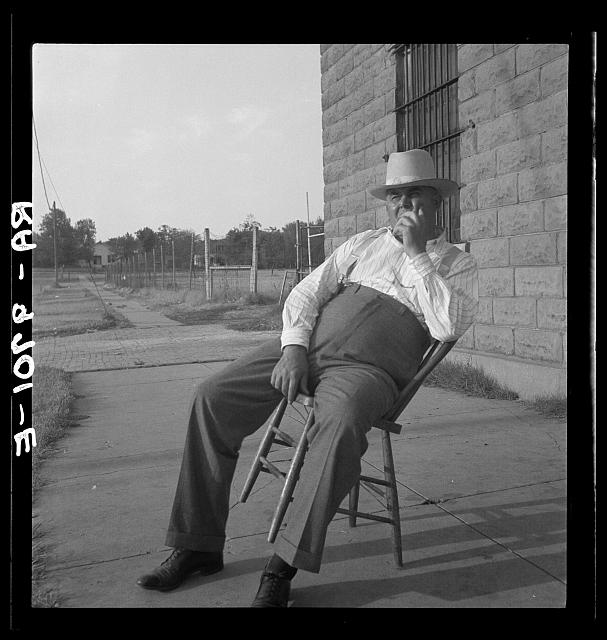 The sheriff of McAlester, Oklahoma, sitting in front of the jail. He has been sheriff for thirty years