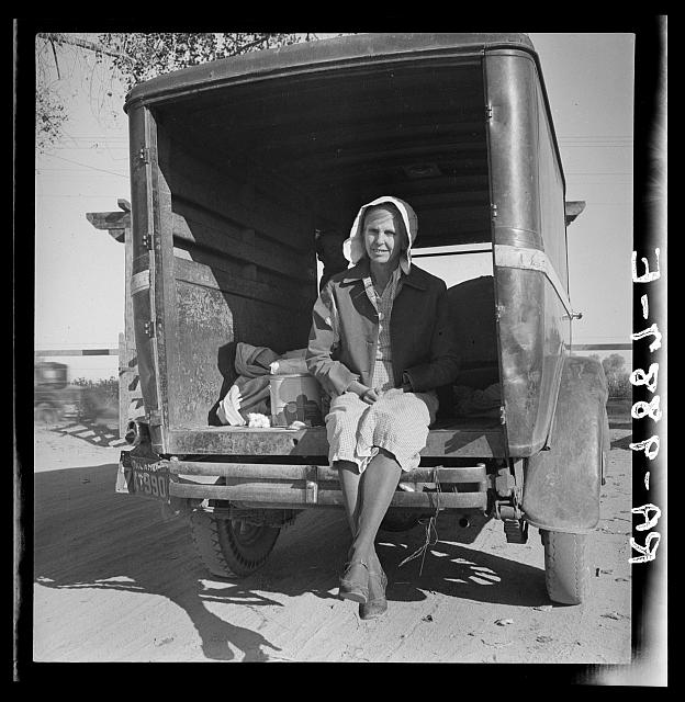 Migrant cotton picker on way to field. Kern migrant camp, California