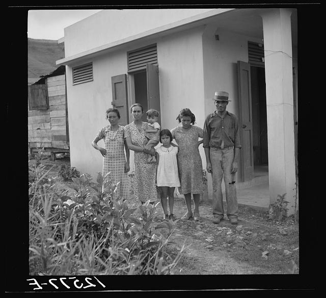 A Puerto Rican family of 5.2. A resettler's family in front of their hurricane-proof house on La Plata project. Puerto Rico