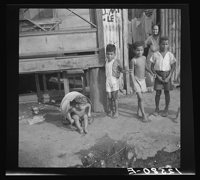 Children in the workers' quarter of Puerto de Tierra. San Juan, Puerto Rico