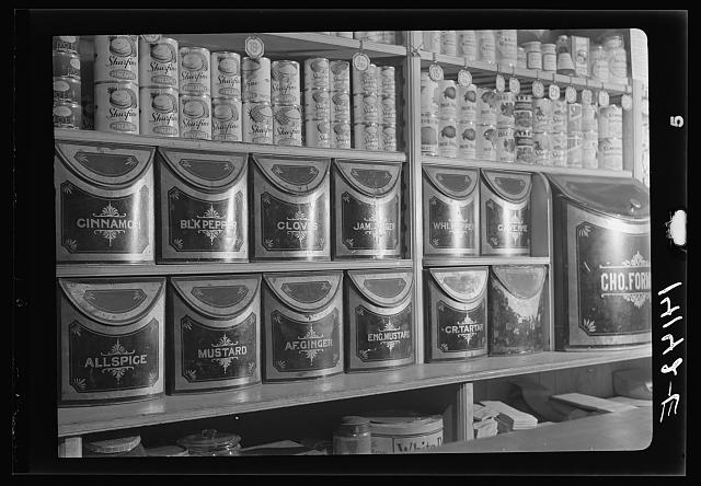 Forty-year-old spice jars in Miller and Brown's store. Wilson, New York