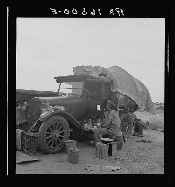 Potato picker in camp near Shafter, California