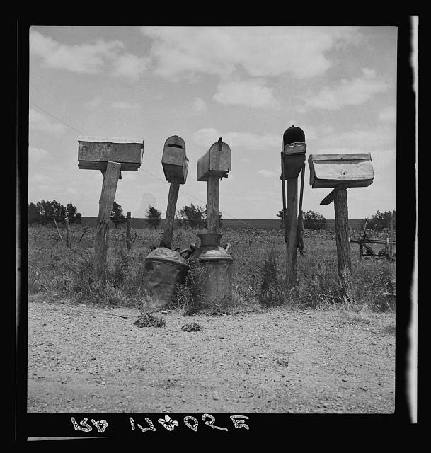 Mail boxes in Bell County, Texas. Three of these mail boxes are not in use. The tenant farmers have been replaced by tractor farming