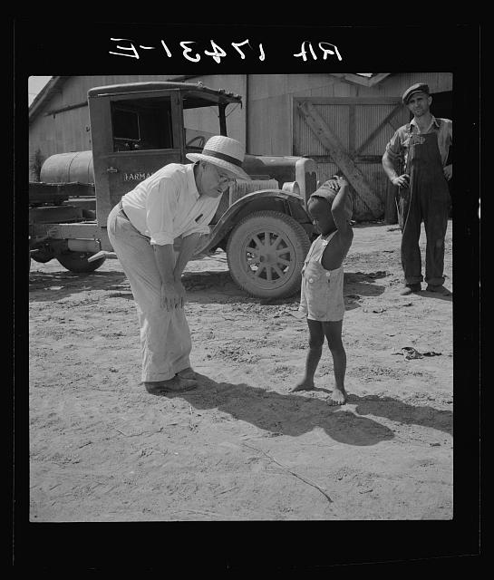 Plantation owner with one of the Negro plantation children. Aldridge Plantation, Mississippi