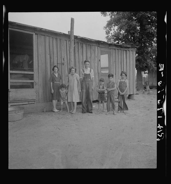 Part of a family of ten children who live and farm in the area which was flooded in the spring of 1937. They escaped in a boat