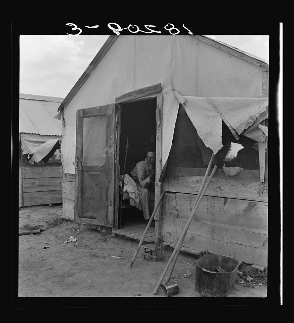 "Refugee agricultural laborer on the roadside in Arizona, near the Casa Grande project (Farm Security Administration). ""I was on this here project, Work Projects Administration, at twenty-three dollars and ten cents in Durant, Oklahoma. I sold a cow to get here. I'd go back tomorrow if I could. The project over there? I wouldn't like it. Your chickens would get all mixed up with the other peoples, and then there'd be trouble. It's kind of socialism over there"""