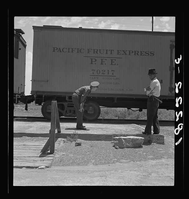 Inspecting a freight train from Mexico for smuggled immigrants. El Paso, Texas