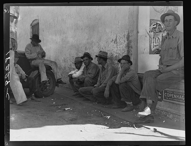 Migrant agricultural workers, idle in town during the potato harvest.  Shafter, California