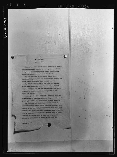 Camp bulletin board in Shafter camp for migratory workers, Farm Security Administration (FSA) camp, California. This notice is a statement of self-determined policy drawn up by the camp committee of elected officers, known as the camp council