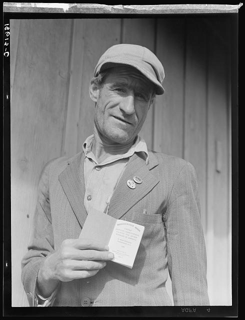 "From Oklahoma farm (April 1938) to strike leader in California. Cotton strike (Nov. 1938). He displays his union membership book. ""Vote No on No. 1"" refers to proposed anti-picketing law which was later defeated by California electorate. Kern County, California"