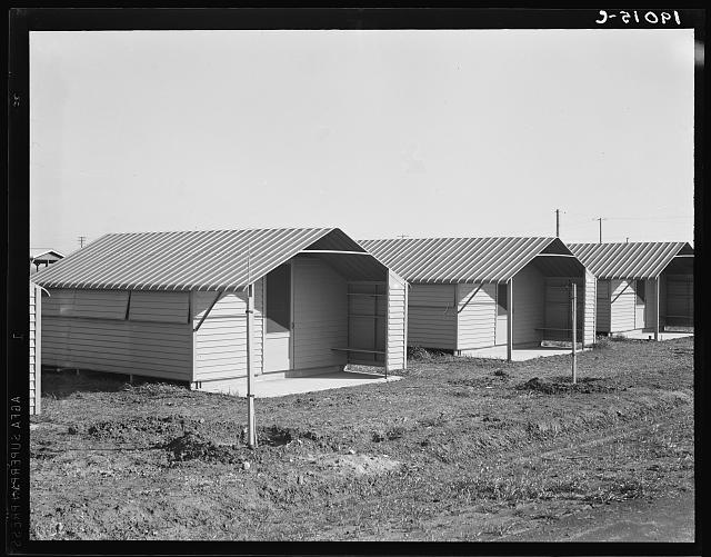 United States government camp for migrant workers (Farm Security Administration-FSA), Westley, California. Pre-fabricated steel shelters replace the use of tents and tent platforms in this newly constructed camp