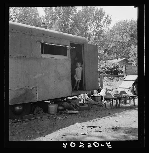The house trailer and the youngest little girl. Washington, Yakima Valley, Toppenish