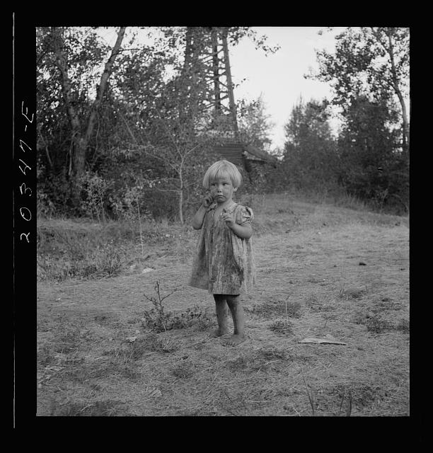Migratory child in squatter camp before hop season opens. Her little brothers work in the field. Washington, Yakima Valley