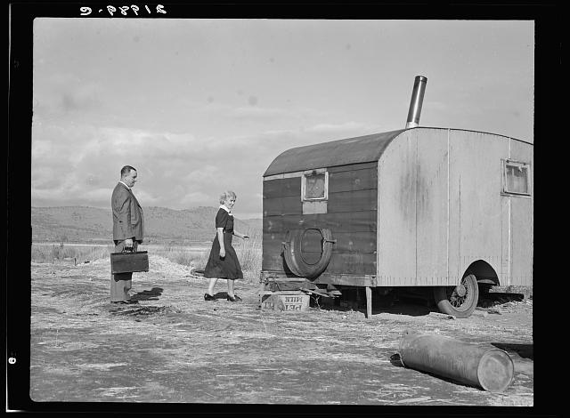 Nurse in FSA (Farm Security Administration) mobile camp unit conducts doctor to house trailer where there is a sick child. Merrill, Klamath County, Oregon