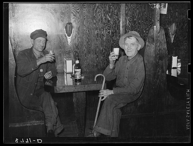 Farmer and ex-cowboy drinking beer in North Platte, Nebraska, saloon