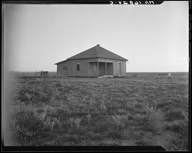 Abandoned house and land, Hall County, Texas. There were formerly twelve families employed on this land, now there are none