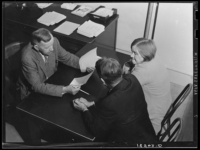 Night meeting in the Farm Security Administration (FSA) office, Rural Rehabilitation Division, Visalia, Tulare County, California. 144 families have applied for Farm Purchase Loans under the Farm Tenancy Act, passed by Congress in 1937. Ten applicants from this region of four counties will be finally selected