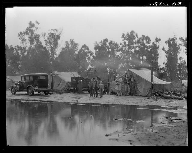 Migrant pea pickers camp in the rain. California