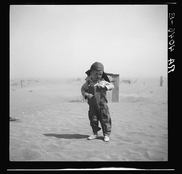 Son of farmer in dust bowl area. Cimarron County, Oklahoma