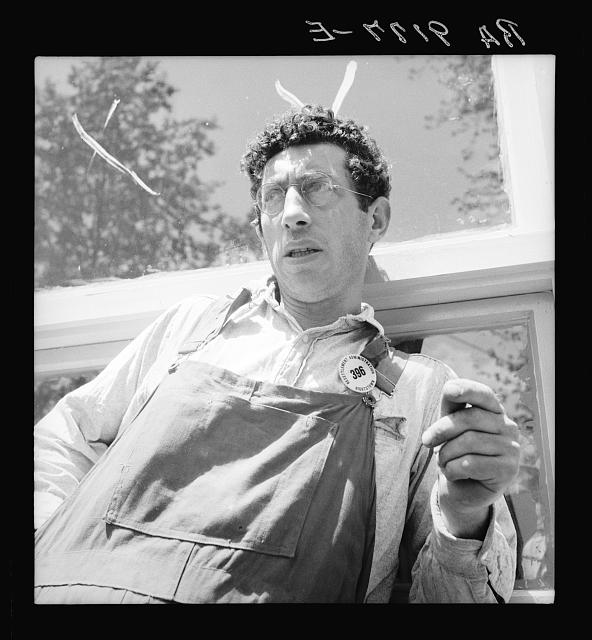 "Accepted applicant for resettlement on the Hightstown project. Jewish-American. This man is already employed on the project as carpenter, working on the nearly completed first unit of thirty-five houses. He says, ""Will we succeed?  Any people who will go through what we did--any people with such patience--will succeed"""