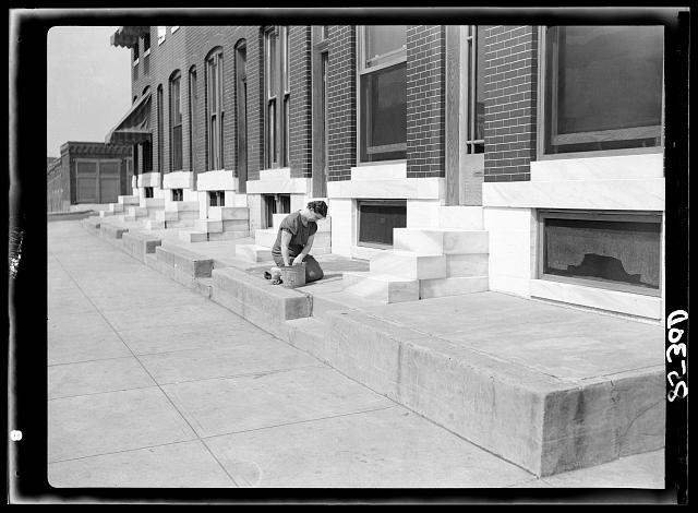 Scrubbing white steps. Baltimore, Maryland