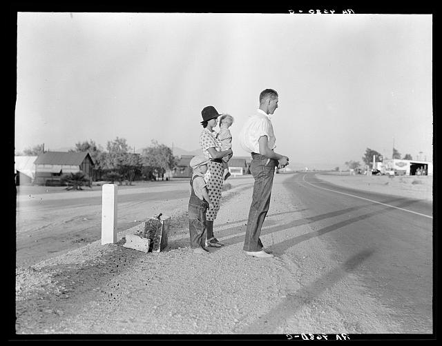 Example of self-resettlement in California. Oklahoma farm family on highway between Blythe and Indio. Forced by the drought of 1936 to abandon their farm, they set out with their children to drive to California. Picking cotton in Arizona for a day or two at a time gave them enough for food and gas to continue. On this day, they were within a day's travel of their destination, Bakersfield, California. Their car had broken down en route and was abandoned