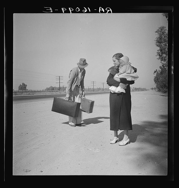 Young family, penniless, hitchhiking on U.S. Highway 99 in California. The father, twenty-four, and the mother, seventeen, came from Winston-Salem, North Carolina. Early in 1935, their baby was born in the Imperial Valley, California, where they were working as field laborers