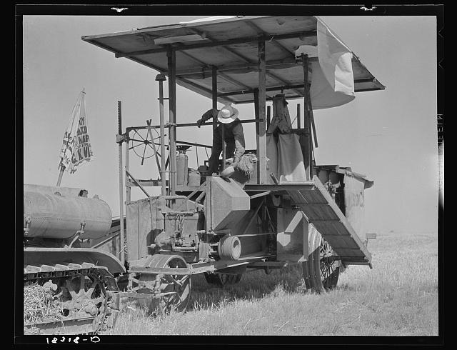 Combine harvester in California. Wheat field. San Joaquin Valley