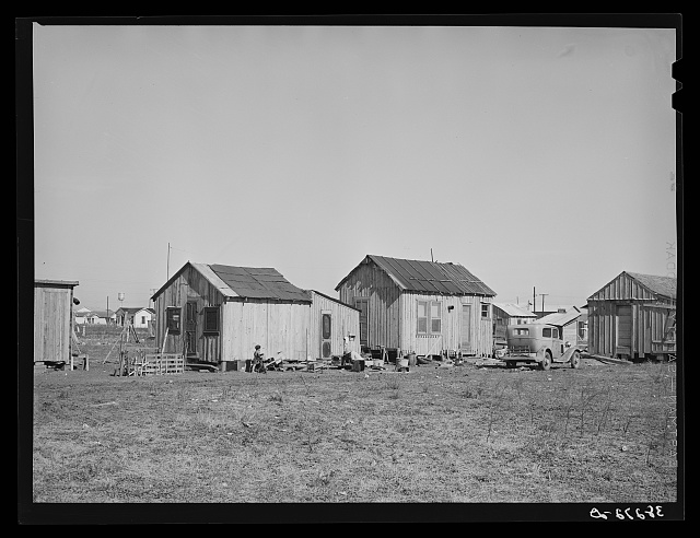 Typical Mexican housing. Corpus Christi, Texas. Many Mexicans as well as whites and Negroes are employed at naval air base construction work