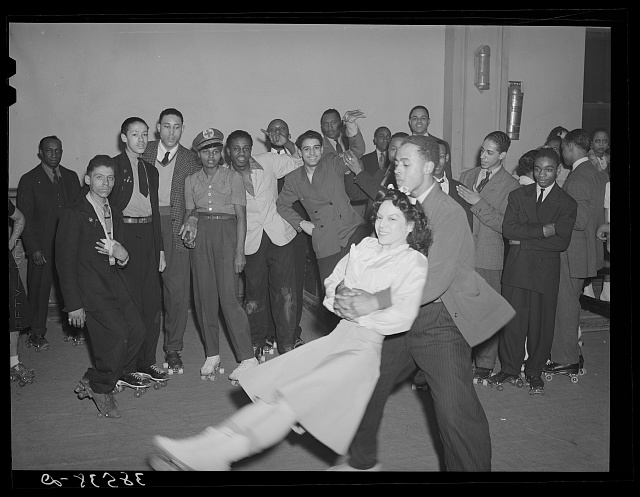 Negro swinging his girl on roller skates. Savoy Ballroom, Chicago, Illinois