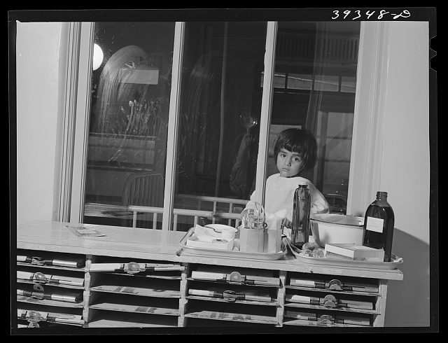 Little Mexican girl in diptheria ward at the county hospital. San Diego, California