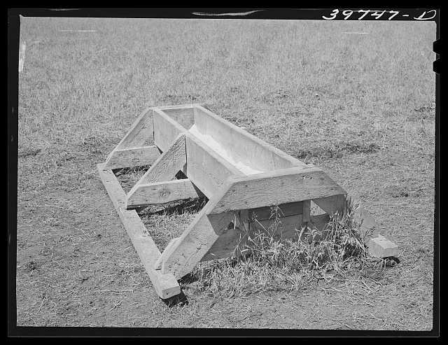 Salt trough. Cruzen Ranch, Valley County, Idaho. This trough can be lashed to horse and dragged to other locations. Notice that grass is not tramped down around trough. AAA (Agricultural Adjustment Administration) has borrowed plans for this trough and expects to make its use one of their standard practices in this section