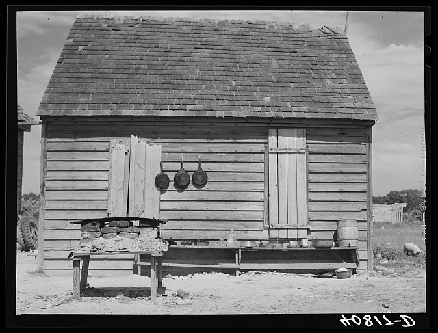 Outdoor Kitchen. Stove in foreground and cooking utensils. Near Old Trap, North Carolina. July 1940